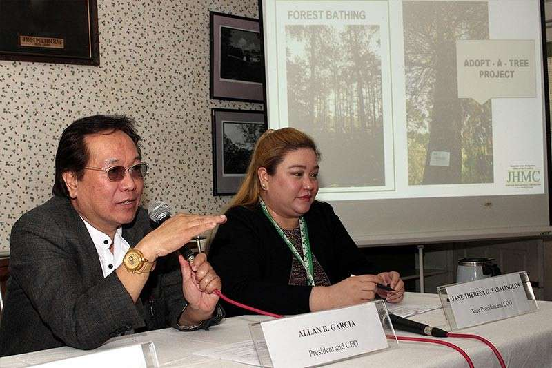 REPORT. Allan Garcia, president and CEO of the John Hay Management Corporation (JHMC) reports on their accomplishments in 2018 during a press briefing. With him is Jane Theresa Tabalingcos, vice - president and COO. Photo by Jean Nicole Cortes