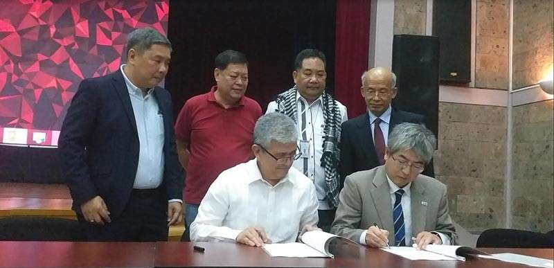 BACOLOD. SRA officials led by Administrator Hermenegildo Serafica (seated, left) sign a joint research agreement with Japan International Research Center For Agricultural Sciences represented by its program director Satoshi Tobita (seated, right) during the Sugarcane Stakeholders' Forum at the Bureau of Soils and Water Management's Convention Hall in Quezon City Monday, February 11, 2019. Also in photo are Sugar Board Members Emilio Yulo III (standing, 2nd from left) and Roland Beltran (standing, left), and Agriculture Undersecretary Segfredo Serrano (standing, 2nd from right). (Erwin Nicavera)