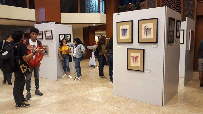"CAGAYAN DE ORO. Kagay-anon artist Michael Bacol, together with the CDO Arts Guild, opened an art exhibit called ""dRawing"" last Saturday, February 9, at the VIP Hotel, along Street, this city. (Jo Ann Sablad)"