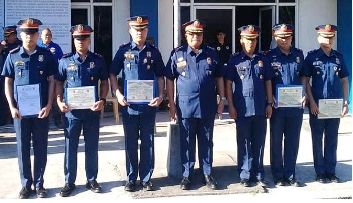 BACOLOD. The awardees of the four top performing police stations, along with Senior Superintendent Henry Biñas (4th from right), officer-in-charge of Bacolod City Police Office, in rites held at the headquarters on Monday, February 11. (Photo courtesy of Bacolod City Police Office)