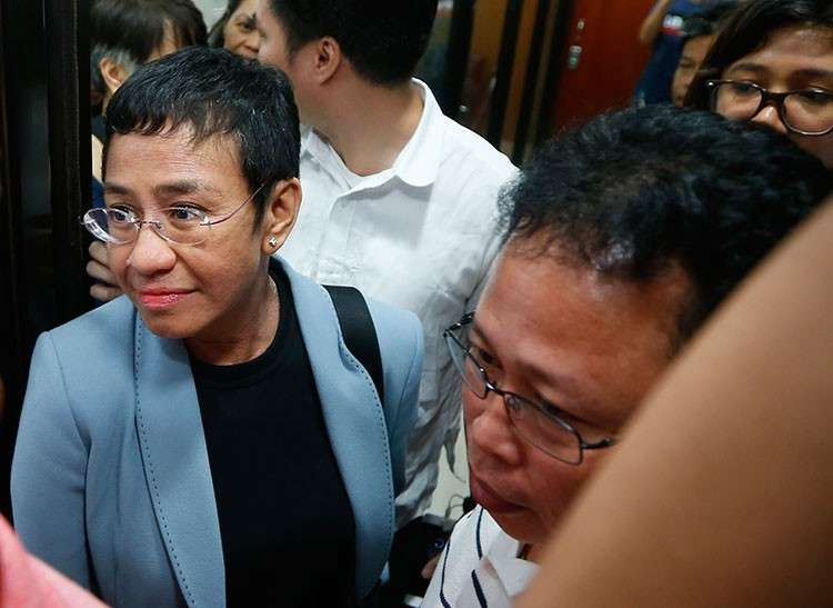 MANILA. Maria Ressa, the award-winning head of a Philippine online news site Rappler that has aggressively covered President Rodrigo Duterte's policies, is escorted into another room following her arrest by National Bureau of Investigation agents in a libel case Wednesday, February 13, 2019. (AP)