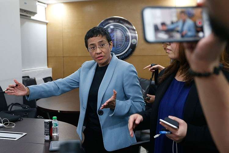 MANILA. Maria Ressa, head of online news site Rappler that has aggressively covered President Rodrigo Duterte's policies, gestures while talking to the media after being arrested by National Bureau of Investigation agents in a libel case Wednesday, February 13, 2019 in Manila. (AP)