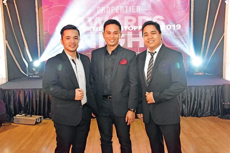 DAVAO. (From left) SEVP Marketing and operations Jaz Mendros, Propertier president Arthur Gonzales, and SEVP for ITSD and Data Analytics Larrie Bernd Rocha during the Propertier Awards Night at Royal Mandaya Hotel. (Macky Lim)
