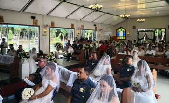 LEYTE. Nine couples who are members of the Philippine National Police in Eastern Visayas exchange vows during a mass wedding at the Immaculate Heart of Mary Chapel, Camp Kangleon, Palo, Leyte on February 14, 2019. (Contributed photo)