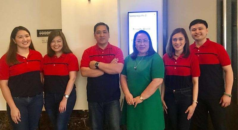 RWM'S THRILL TEAM. The sales and marketing team of Resorts World Manila at the Cebu Travel Catalog International offering thrills and exclusive deals, from left, travel trade assistant manager Ina Abogada, senior director hotel sales and marketing Kathy Mercado, chief integrated marketing officer Martin Paz, public relations assistant manager Joy Andrade and assistant public relations director Archie Nicasio. With them is Angelita Dy of Grand Hope Travel, general sales agent of RWM in Cebu.