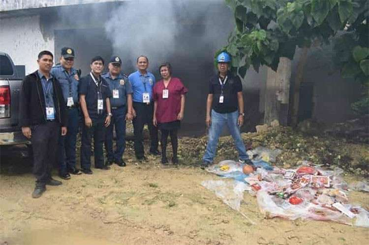 CEBU. Witnessing the disposal held near the Mactan Cebu International Airport were Dr. Daniel Ventura, Department of Agriculture-Central Visayas' ASF Task Force spokesperson, and personnel of the Bureau of Customs and Philippine National Police. (Photo courtesy of DA-Central Visayas)