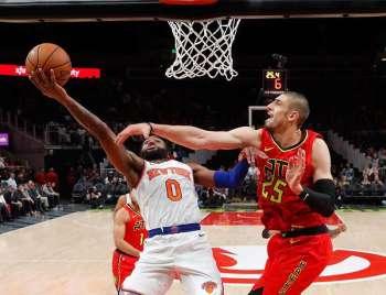 GEORGIA. New York Knicks guard Kadeem Allen (0) gos in for a basket as Atlanta Hawks center Alex Len (25) defends during the first half of an NBA basketball game Thursday, February 14, 2019, in Atlanta. (AP)