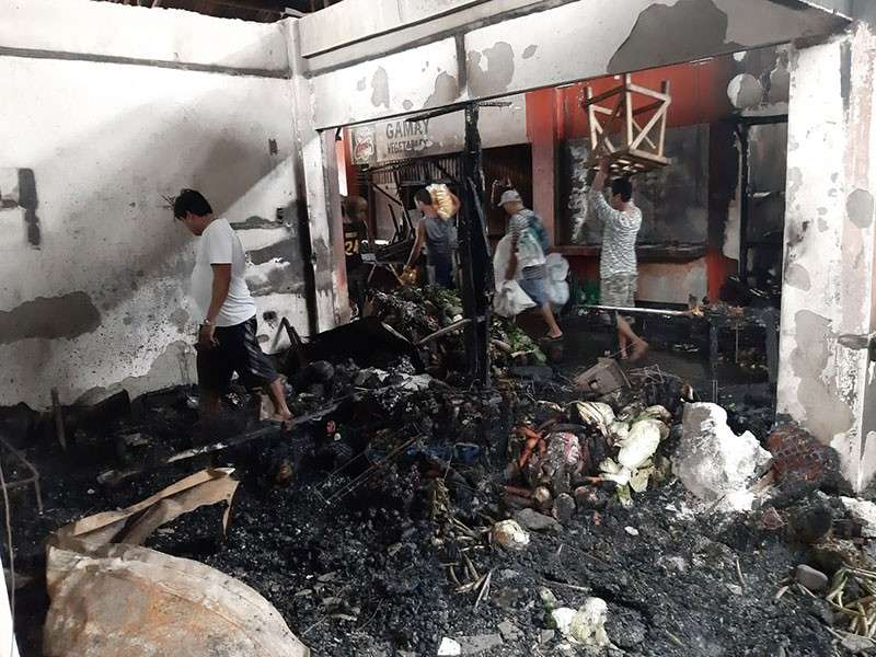 BACOLOD. The debris of the fire that left an estimated damage of P58 million worth of properties inside the public market of Manapla town in Negros Occidental early Friday, February 15. (BFP-Manapla)