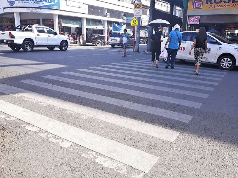 DAVAO. Pedestrians naturally use the pedestrian lane to safely cross the road. (Contributed photo)