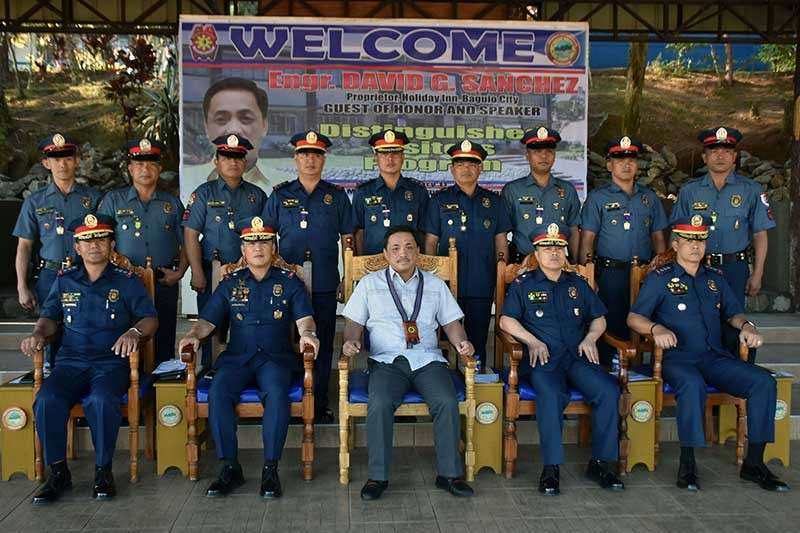 AWARDEES. Baguio City entrepreneur Engr. David Sanchez assisted by Police Regional Office-Cordillera Regional Director PCSupt. Rolando Nana and Deputy Regional Director for Administration PCSupt. R'win Pagkalinawan led the awarding ceremony of police officers in recognition of their anti-criminality efforts last week. Engr. Sanchez, Proprietor of the Holiday Inn Baguio City, was the Guest of Honor and Speaker during the Monday Flag Raising Ceremony and Distinguished Visitors Program at the PRO-Cor, Camp Bado Dangwa in La Trinidad, Benguet last week. (Redjie Melvic Cawis)