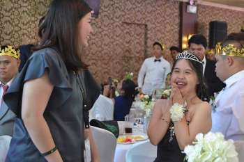 CROWNING GLORY. Pure joy was radiating from this young lady after her buddy crowned her during the Night to Shine 2019. (RJ Lumawag)