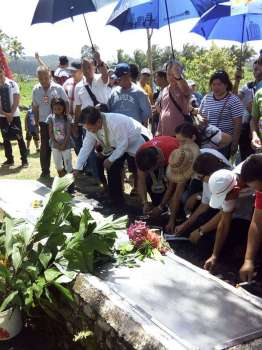 SOUTHERN LEYTE. Lone District of Southern Leyte Representative Roger Mercado (in white barong) and Governor Damian Mercado (in red polo shirt), along with other local officials and residents, pay tribute to the victims of the 2006 Guinsaugon landslide in St. Bernard, Southern Leyte during its 13th commemorative mass and program on February 17, 2019. (Photo courtesy of Diego Credo)