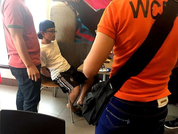 CEBU. Online trafficker Joey Michael Donozo was arrested in an entrapment operation in Cebu City on February 16, 2019. (IJM photo)