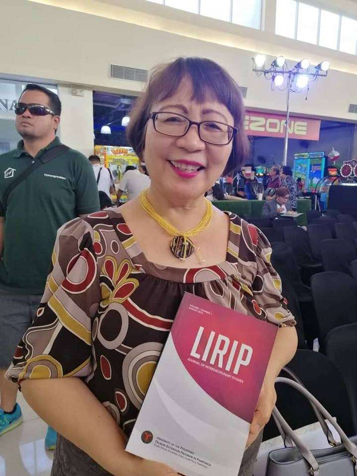PAMPANGA. Dr. Juliet Mallari shows a copy of 'Lirip' during the kick-off of the National Arts Month celebration held at Vista Mall in the City of San Fernando. (Nicole Renee David)