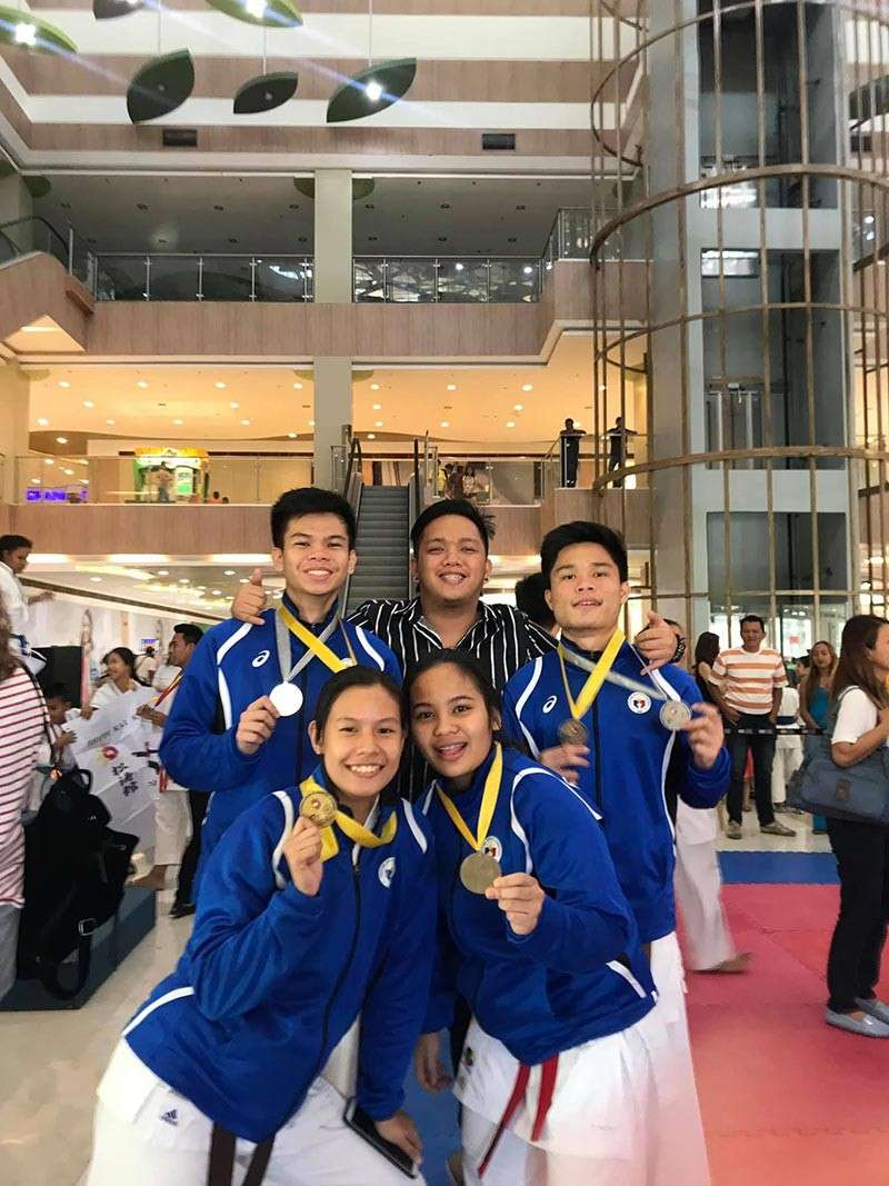 MEDALISTS. Some members of the AAK Fairlanes medalists, led by Gabriel Quiñones and Julian Ambrose Ramirez, pose after the awarding ceremonies of the 1st Karate Pilipinas Region 11 championships held Sunday at the Gaisano City Gate. (Photo from Gabriel Quiñones Facebook)
