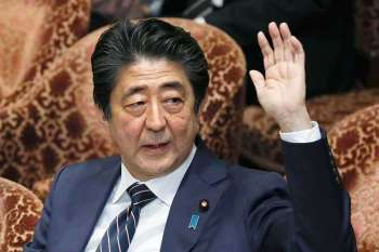 JAPAN. Japanese Prime Minister Shinzo Abe raises his hand during a parliamentary session at the Lower House in Tokyo, Monday, Feb. 18, 2019. Abe and his chief spokesman have declined to say if Abe nominated President Donald Trump for a Nobel Peace prize. (AP)
