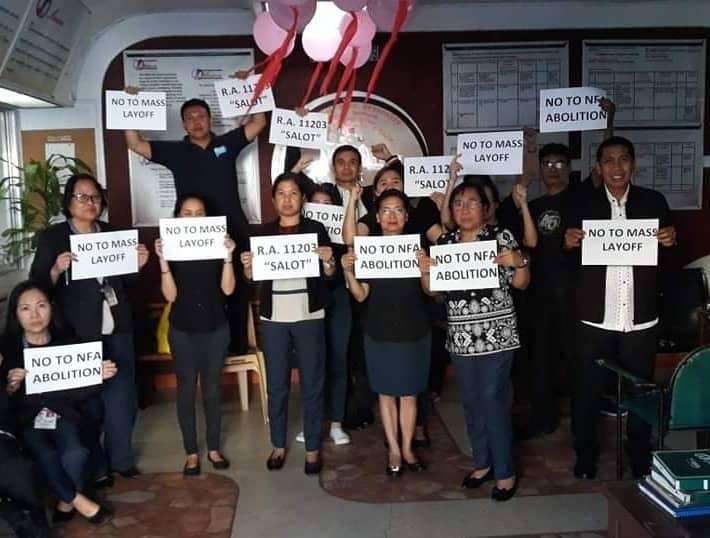 "BACOLOD. National Food Authority employees led by Provincial Manager Frisco Canoy (right) during their ""Black Protest"" against the newly-signed rice tariffication law at the agency's office in Bacolod City on Monday, February 18. (Contributed photo)"