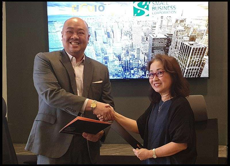 In photo are Small Business Corporation President and CEO Ma. Luna Cacanando (right) and Curo Teknika Chief Operating Officer Jeff Tinio.