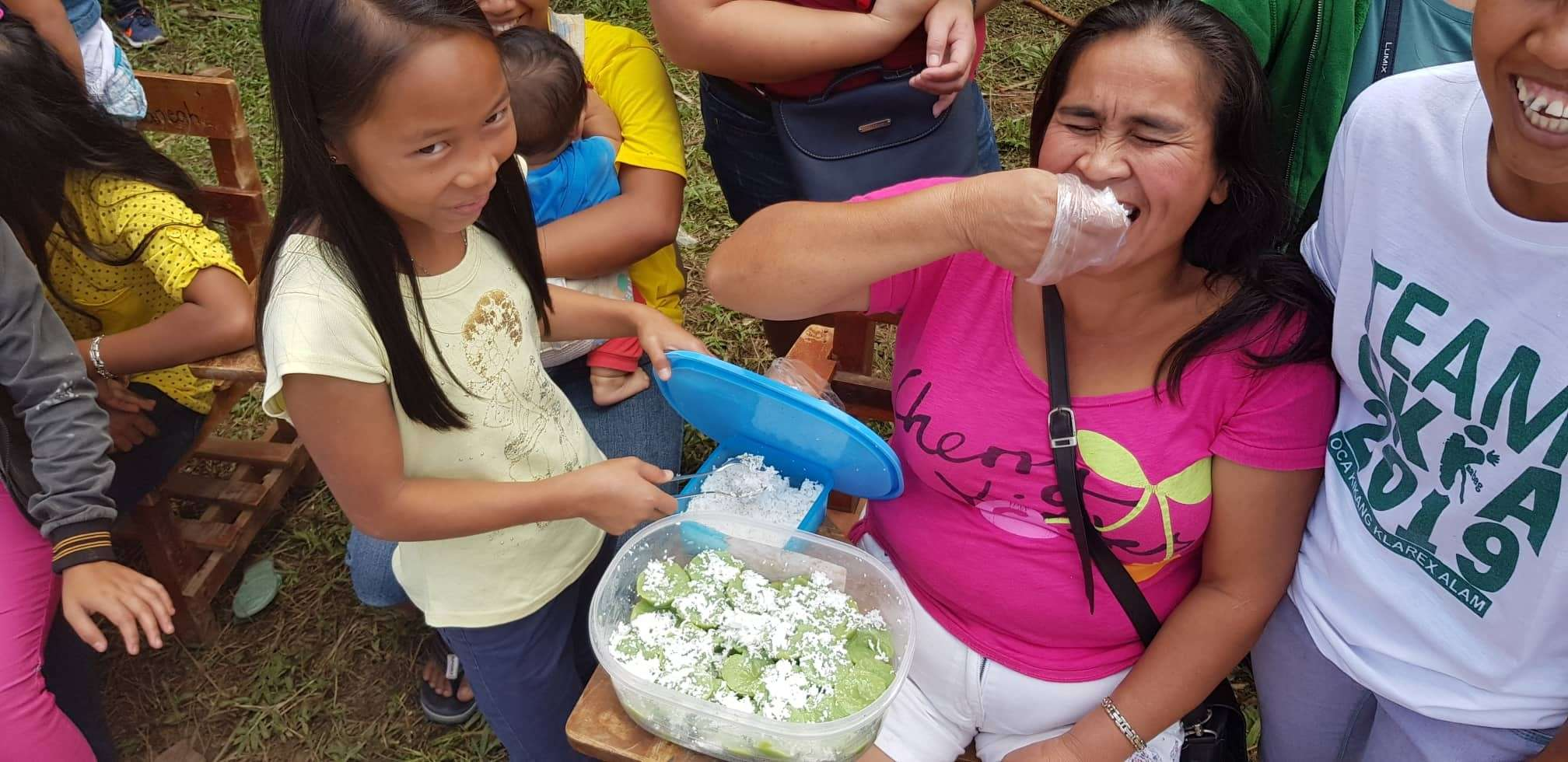 CAGAYAN DE ORO. A mother eats a piece of