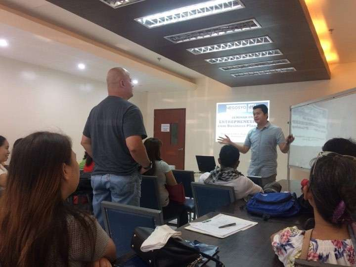 Business counselor Gabriel Advincula (standing right) speaks before the OFW participants of the entrepreneurship and business planning seminar held at Negros First Negosyo Center in Bacolod City Tuesday, February 19. (Contributed Photo)