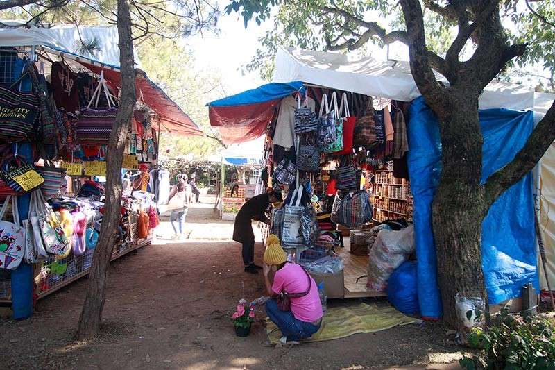 BAGUIO. The Baguio Blooms market encounter stalls still remain at the Burnham skating rink area. Last week, Mayor Mauricio Domogan has given into calls made by the legislative body to pullout the trade fair and transfer to the Gangza Parking area. Photo by Jean Nicole Cortes