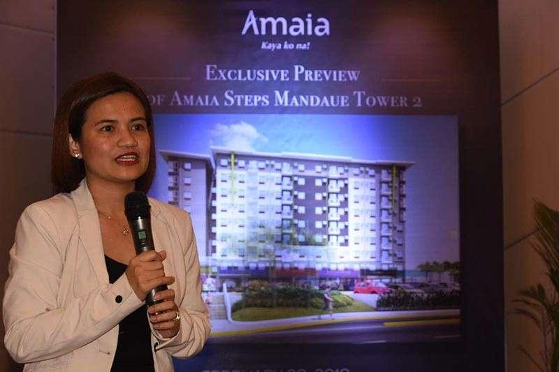 PREVIEW. Grace Calingasan-Guinto, project development head of  Amaia Land, gives the media a preview of Amaia Steps Mandaue Tower 2. (SunStar photo / Allan Cuizon)