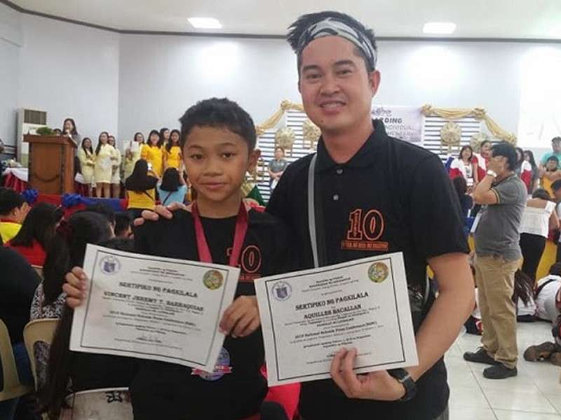 PANGASINAN. Vincent Jeremy Barraquias with coach Aquiles Bacallan at the 2019 National Schools Press Conference in Lingayen, Pangasinan. (Contributed photo)