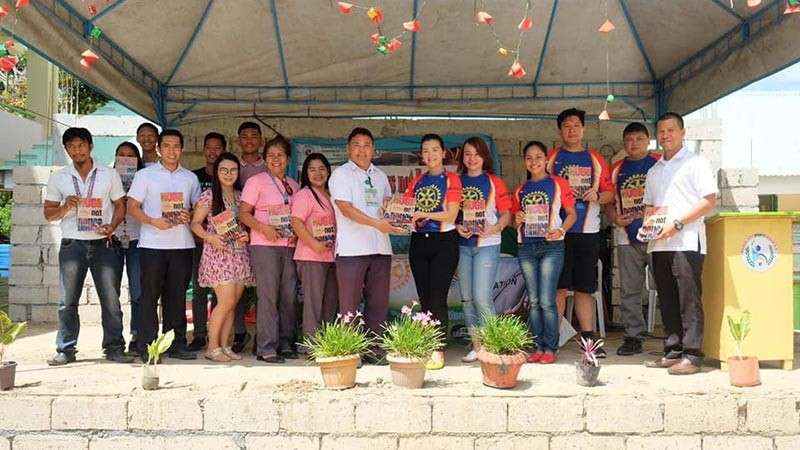"ORMOC. The Rotary Club of Ormoc Bay, through its President Apple Anido Alagon, distributes at least 600 books entitled ""Hugs, not Drugs"" to 20 high schools in Ormoc City as part of its anti-drug advocacy. (Contributed photo)"