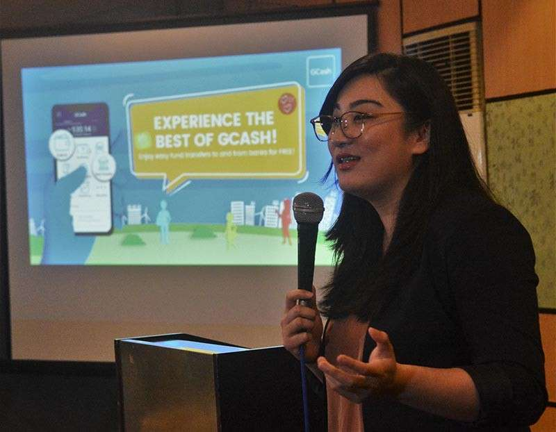 QUICKER AND EASIER. Zoe Ann Denise Ocampo, manager for fund management of Mynt, parent company of GCash, explains how GCash free fund transfer works. (SunStar photo / Amper Campaña)