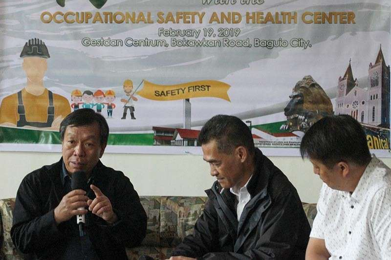 BAGUIO. In an effort to promote occupational safety and health among workers, DOLE regional director Exequiel Ronie Guzman (left) encourages companies to join the search for the 11th Gawad Kaligtasan at Kalusugan during a press briefing. With him is German Eser, chief of the training and public information division of DOLE; and Hollis Fernandez, senior manager SN Aboitiz Power-Benguet and project HSE manager of safety, health, environment, security and quality (SHESQ). (Photo by Jean Nicole Cortes)