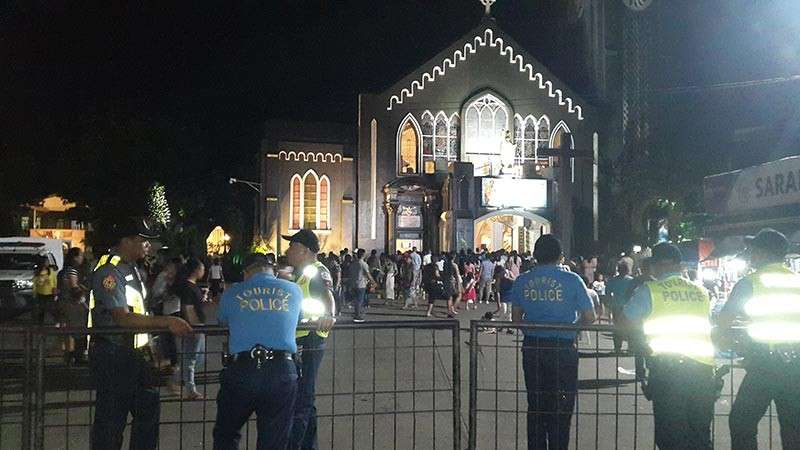 CAGAYAN DE ORO.  Police step up security measures at the City Cathedral and various places of worship in the City of Golden Friendship, especially during Sunday Mass. (Photo by Lynde Salgados)