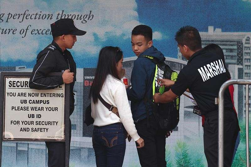 BAGUIO. Security guards and marshals at the University of Baguio tighten security following a bomb scare. (Photo by Jean Nicole Cortes)