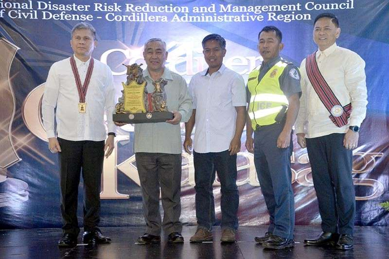 BENGUET. La Trinidad, Benguet officials headed by Mayor Romeo Salda joins OCD administrator Undersecretary Ricardo Jalad and CDRRMC officials during the Cordillera Gawad Kalasag regional awarding ceremony on February 20. La Trinidad, the region's Best local DRRM Council (1st - 3rd class municipality category) also bagged the national GK award for the category. (Photo by Lito Dar)