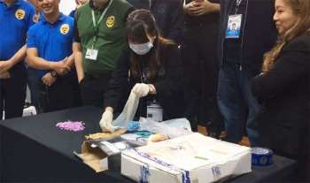 MANILA. The Bureau of Customs and Philippine Drug Enforcement Agency show to media Friday, February 22, the ecstasy tablets recovered at the Ninoy Aquino International Airport on February 21, 2019. (Screenshot from BOC Facebook video)