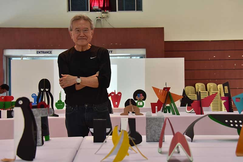 DAVAO. Architect Benhui Uy poses with his sheet-metal and cardboard box artworks. (Macky Lim)