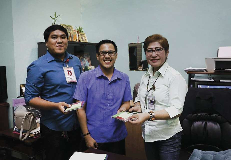 DELIVERING DATA. NHTU officers Hillton John V. Edrial and Donald Rey Dejacto hand over the data to Private Data Officer Marivic Racho-Garces. (Contributed foto)