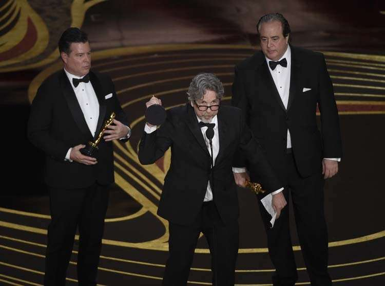 USA. Brian Hayes Currie, from left, Peter Farrelly and Nick Vallelonga accept the award for best original screenplay for