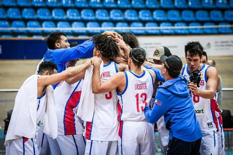 CELEBRA-TION. Members of Gilas Pilipinas celebrate seconds after the final whistle as they nab their slot to the Fiba World Cup in China later this year. (Photo from FIBA.com)