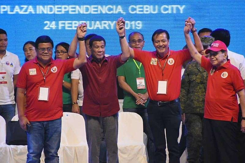 PRESIDENTIAL ENDORSEMENT. President Rodrigo Duterte raises the hands of Cebu City mayoral tandem Edgardo Labella (left) and Michael Rama (right) during the PDP rally at Plaza Independencia on Sunday, Feb. 24. What does this mean for Rama who has been named by the President as a narco-politician? See who else got the President's endorsement on pages 6-7. (SunStar photo / Allan Cuizon)