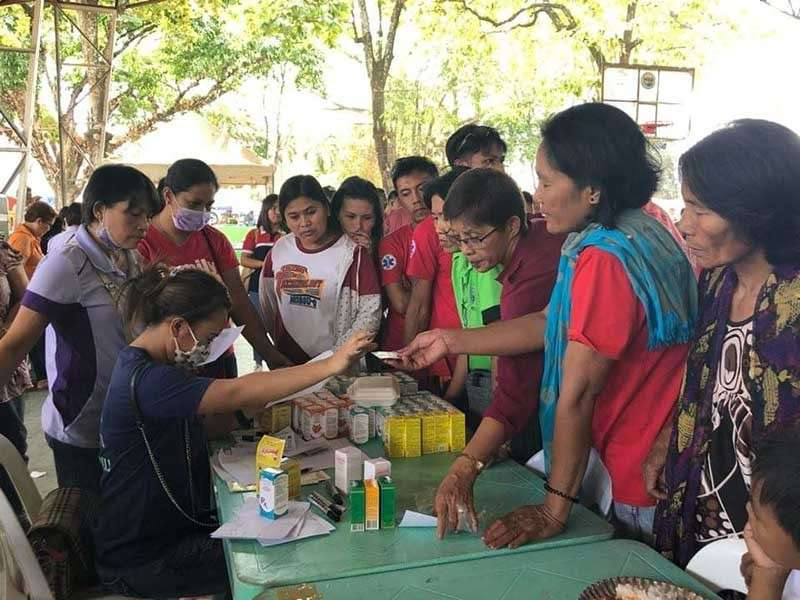 NEGROS. Healthcare providers give medicines to the beneficiaries of medical mission held at the covered court of Isabela town in Negros Occidental on Sunday, February 24. (Contributed photo)