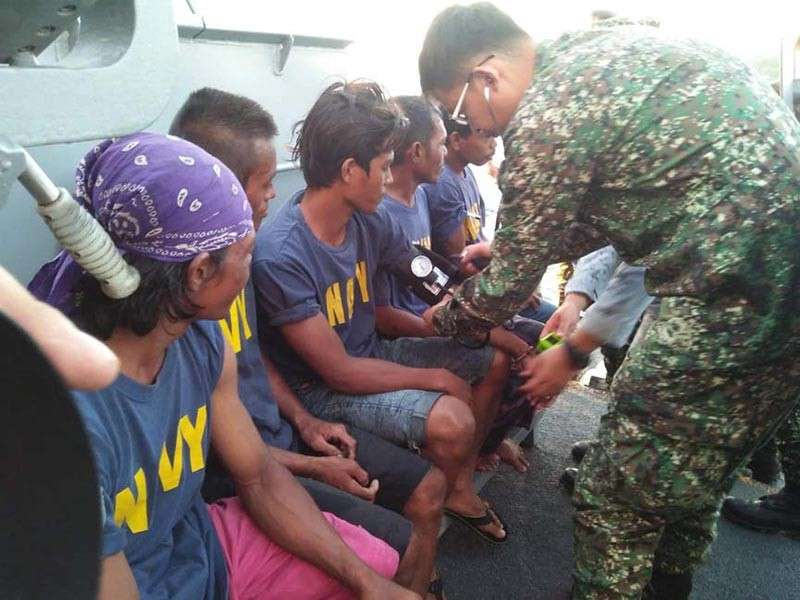 ZAMBOANGA. A Navy medic checks the blood pressure of the rescued crewmen of M/L Jomong, a vessel in distress that was rescued by the Naval Task Group Tawi-Tawi on Monday, February 25, 2019, as it drifted at sea off the province of Tawi-Tawi. (Contributed Photo)