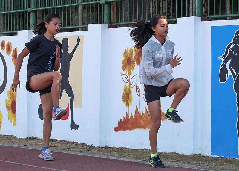 PRIME ATHLETES. Baguio City National High School Grade 9 students, Airah Mae Gali and Erica Bulatao are determined to emerge as champions in the ongoing CARAA meet at Apayao. Bulatao will compete in the triathlon event for CARAA. (Photo by Jean Nicole Cortes)
