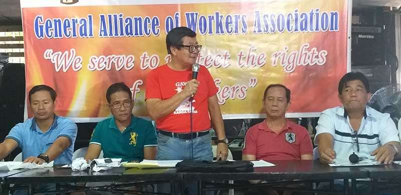 ILOILO. Labor representatives to the Regional Tripartite Wages and Productivity Board in Western Visayas Wennie Sancho (center) and Hernane Braza (2nd from right) during the workers' forum against sugar import liberalization earlier this month. (Erwin Nicavera)