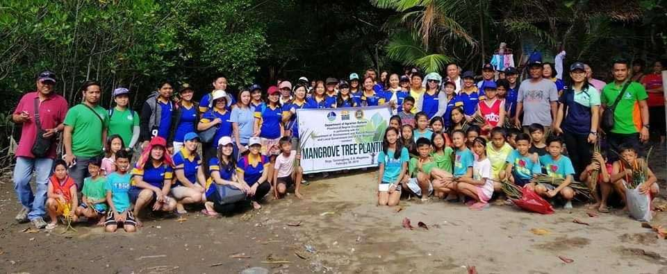 NEGROS. Personnel of Department of Agrarian Reform-Negros Occidental with Department of Environment and Natural Resources personnel, barangay officials and staff, and student-volunteers during the mangrove planting activity held at the coastline of Barangay Tomongtong in E.B. Magalona town on Tuesday, February 26. (Contributed photo)
