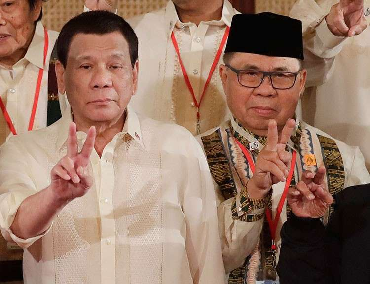 MANILA. In this Friday, February 22, 2019, file photo, Moro Islamic Liberation Front chairman Murad Ebrahim (right) and President Rodrigo Duterte flash peace signs following oath-taking ceremony for the creation of the Bangsamoro Transition Authority at the Presidential Palace in Manila. (AP)