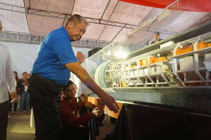 MANILA. Transportation Secretary Arthur Tugade leads on Wednesday, February 27, the unveiling of the scale model of the Tunnel Boring Machine (TBM) that will be used in the construction of the Metro Manila Subway. (Photo from DOTr Facebook page)