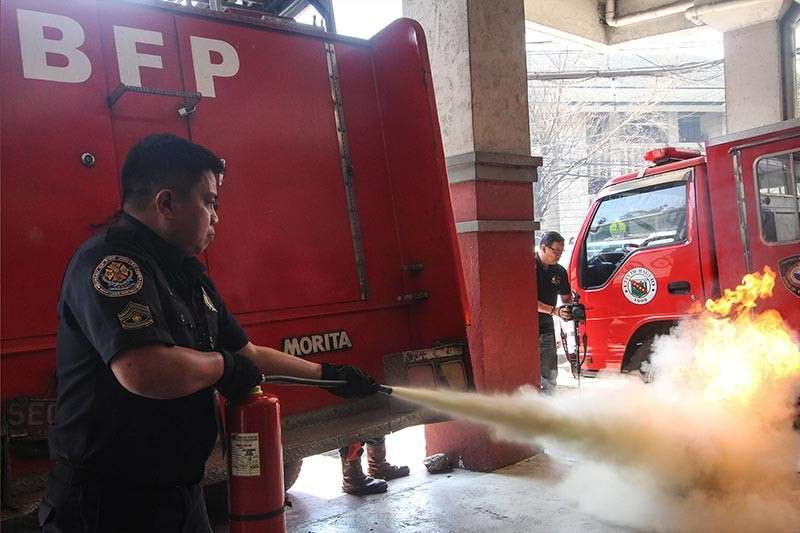 BAGUIO. The Bureau of Fire Protection demonstrates how to properly put out a fire using a fire extinguisher. The BFP Cordillera is exerting effort to disseminate information on how to prevent fire at home or in any other places. (Photo by Jean Nicole Cortes)