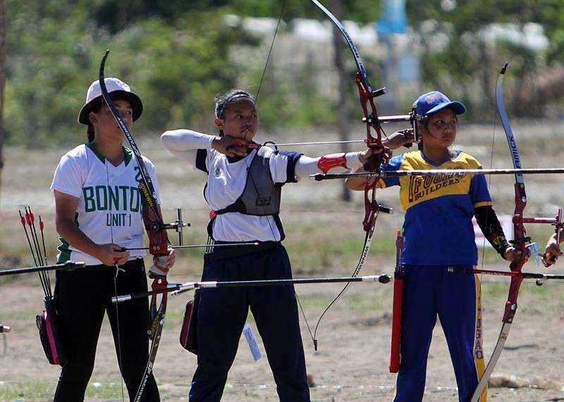 BAGUIO. Baguio's Angela Villamor sets aim during the archery tournament of the Cordillera Administrative Region Athletic Association (Caraa) at the Apayao Eco–Tourism and Sports Complex in Payanan, Luna. (Photo by Roderick Osis)