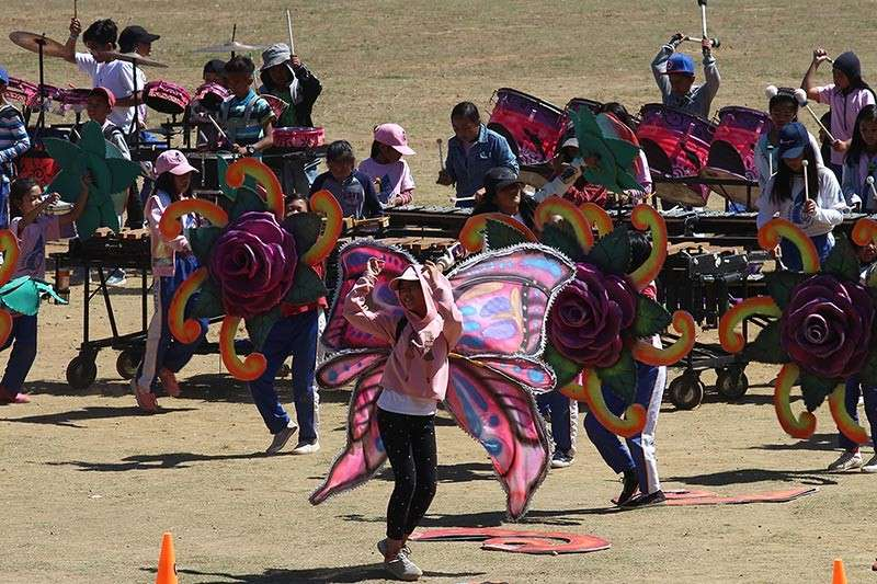 BAGUIO. Students rehearse their drum and lyre piece to be performed during the Panagbenga grand street parade. (Photo by Jean Nicole Cortes)