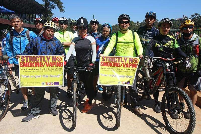 BAGUIO. Members of the Baguio Daily Cycle movement arrive at the Baguio Athletic Bowl after a parade led by the Baguio City Smoke-Free Task Force on February 28. (Photo by Jean Nicole Cortes)